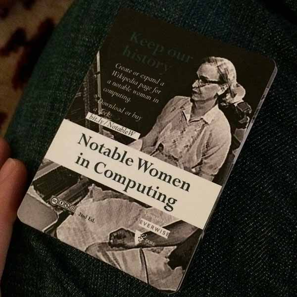 Notable Women in Computing Poster Cards held by Jessica Dickinson Goodman while playing Hearts by the fire.
