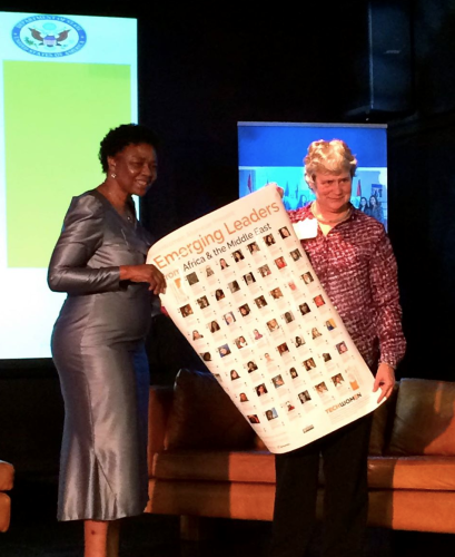 """Katy Dickinson presenting a """"TechWomen Emerging Leaders in Africa and the Middle East"""" poster to Dep. Minister Dept. Telecommunications and Postal Services, Cape Town, South Africa."""